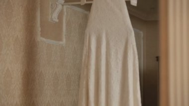 Wedding dress on a hanger — Vídeo stock