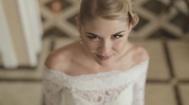 Young bride in tracery wedding dress, top view — Stock Video