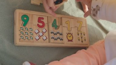 Close-up of wooden developing game with numbers — Stock Video