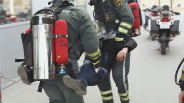 Sevastopol, Crimea, Russia - March 26, 2015: Firefighter exercises. Firemen evacuates man and try to save him — Stock Video