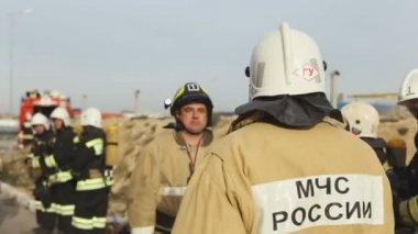 Sevastopol, Crimea, Russia - March 26, 2015: Firefighter exercises. Fireman gives guidance by radio set — Stock Video