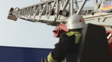 Sevastopol, Crimea, Russia - March 26, 2015: Firefighter exercises. Firemen work on the retractable fire escape stairs, people look at it — Stockvideo