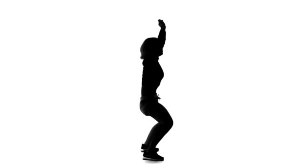 Black silhouette of vigorously dancing on a white background girl — Vidéo
