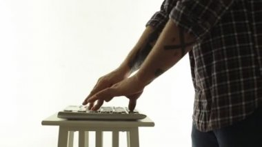 Man DJ masterly playing on an electric music controller — Stock Video
