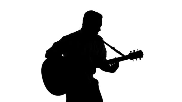 Black silhouette of guy playing guitar on a white background — Vidéo