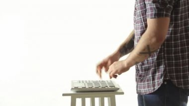 Trendy guy skillfully performs music on Pad Midi Controller — Stockvideo