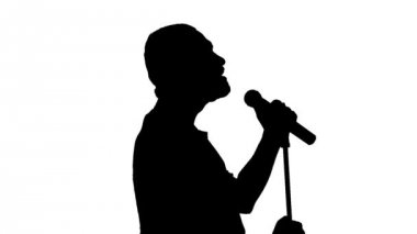 Black silhouette of a singer vigorously singing on a white background — Stock Video