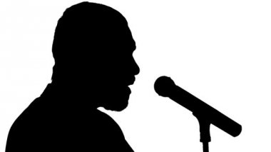 Close-up of a black silhouette of a microphone and vigorously singing singer on a white background — Stock Video