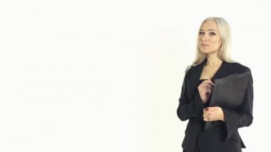 Portrait of a beautiful business woman showing something by hand on a white background in studio — Stock Video