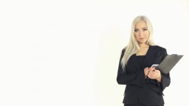 Business woman in jacket talking on the phone on a white background in studio — Stock Video