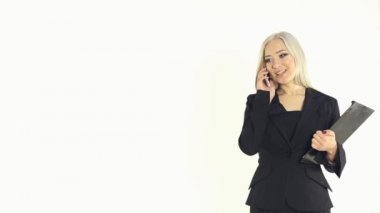 Attractive business woman talking on the phone on a white background in studio — Stock Video