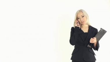 Attractive boss woman talking on the phone on a white background in studio — 图库视频影像