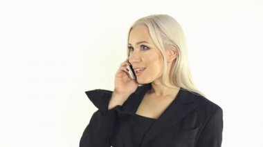 Close-up of businesslike woman in a suit talking on the phone — Stock Video