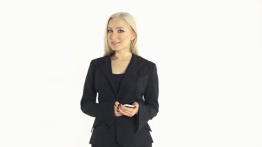 Beautiful business woman in a suit talking on a mobile phone on a white background — Stock Video