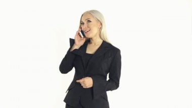 Attractive business woman in a suit talking on a mobile phone on a white background — 图库视频影像