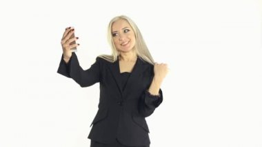 Business woman making selfie photo on a cell phone in the studio on a white background — Stock Video