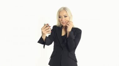 Successful business woman making selfie photo on mobile phone in the studio on a white background — Stock Video