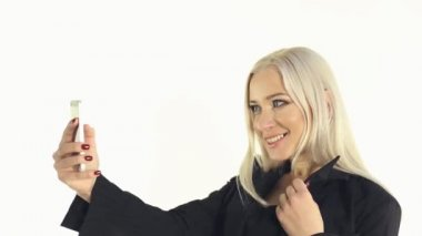 Close-up of business lady doing selfie photo on a white background — Stock Video