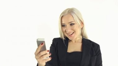 Close-up of making selfie photo for mobile phone by business woman on a white background — Stock Video