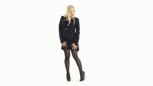 Seductive business woman in stockings and heels on a white background in full length — Vidéo