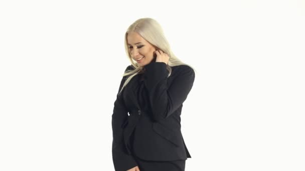 Seductive business woman fooling around and unbuttons jacket on a white background — Vidéo