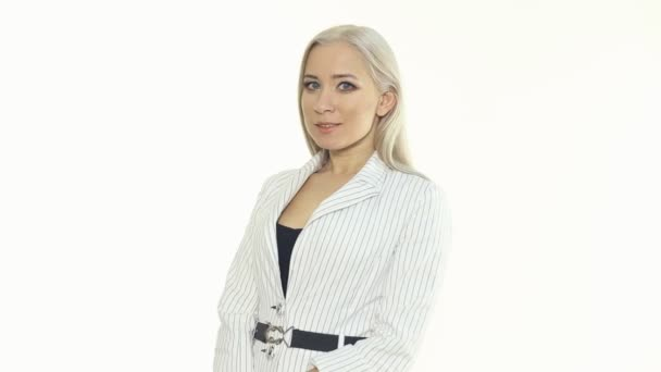 Portrait of self-confident blonde in a white jacket on a white background — Vidéo