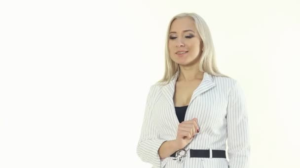 Successful business woman in a white jacket showing something with hand on a white background — Vidéo