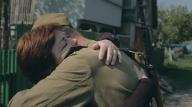 Mother hugging her son a soldier, he goes to war with a friend — Stock Video