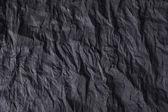 Black embossed background — Stock Photo