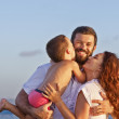 Portrait of positive family on the sunset beach — Stock Photo #80125130