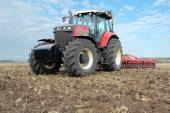 Tractor makes tillage — Stock Photo