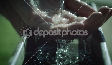 Slow Motion Water Over Hand — Stock Video