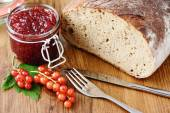 Red currant jam and fresh bread — Stock Photo
