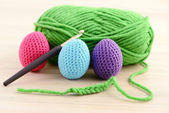 Crocheting easter eggs in green, pink, blue and purple — Stock Photo