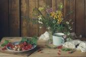 Summer still life with wild flowers and berries — Stock Photo