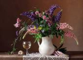 Still life with a bouquet of lupines. — Stock Photo