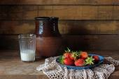 Still life with milk and strawberry — Stock Photo