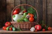 Basket with a vegetable marrow, cucumbers and tomatoes. — Stock Photo