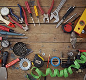 Tools on a timber floor, the top view. — Stock Photo