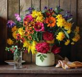 Still life with a bouquet of cultivated flowers and cowberry — Stock Photo