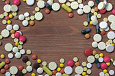 Scattering of medical tablets and capsules. Medicine. Top view. — Stock Photo