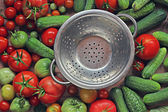 Fresh cucumbers, red and green tomatoes — Stock Photo