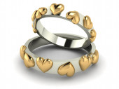 Wedding rings with hearts. — Stock Photo