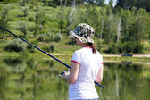 Girl with a fishing rod — Stock Photo