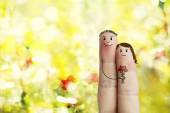 Finger art of a Happy couple. Man is giving bouquet of red hearts. Stock Image — Stock Photo