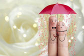 Conceptual finger art. Lovers is embracing and holding red umbrella with falling flowers. Stock Image — Stock Photo