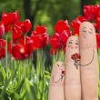 Conceptual family finger art. Father and son are giving flowers his mother. Stock Image. — Stock Photo #71799801