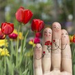 Conceptual family finger art. Father, son and daughter are giving flowers their mother. — Stock Photo #71903213