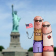 Couple of tourists is celebrating july 4th and holding US flag — Stockfoto #74951547