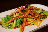 Salad greens with crispy duck — Stock Photo